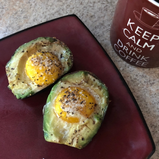 Whole30 avocado baked eggs with coffee